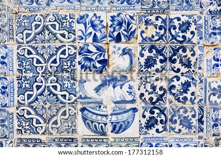 Old azulejos with the bird in Cascais, Portugal.  - stock photo