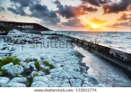 Old Bahia Honda Railroad bridge at sunrise. Florida Keys Islands, USA. - stock photo