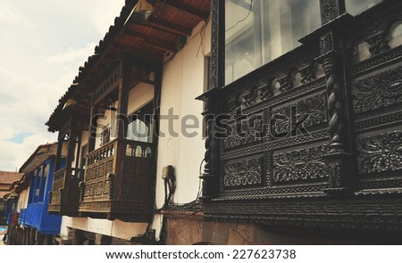 Old balconies in conlonial architectural style, Cusco Peru