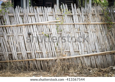 Old bamboo fence in rural area, Thailand