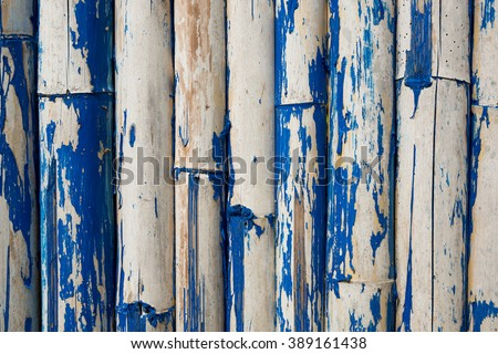 Old bamboo wall with blue stains come loose. - stock photo