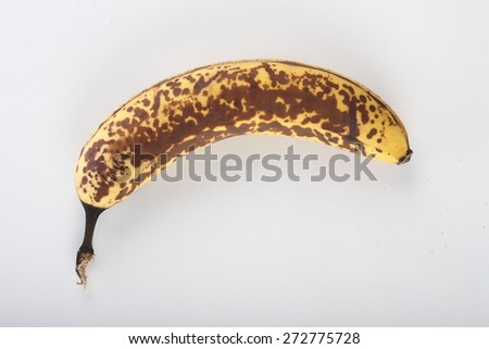 Old banana on white background - stock photo
