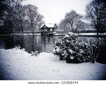 Old bandstand on lake - stock photo