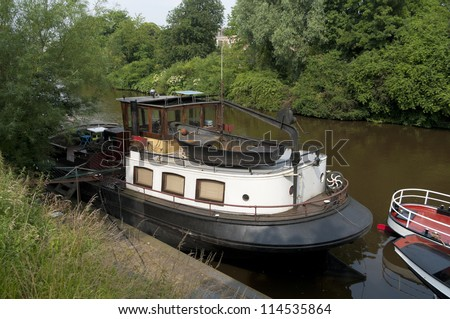 old barge in a canal in Groningen, Netherlands