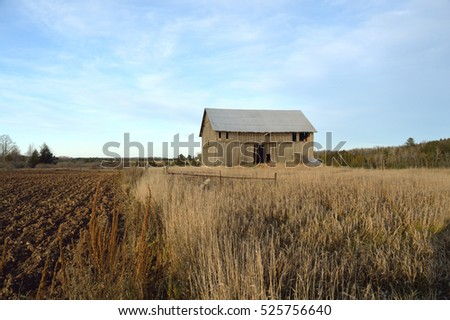 Old Barn covered in blue sky