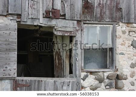 old barn door and window - stock photo
