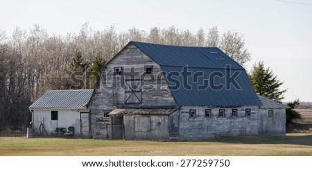 Old barn in a field, Manitoba, Canada - stock photo