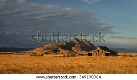 Old barn in front of Bear Butte from Nine Mile Road near Sturgis, South Dakota  - stock photo