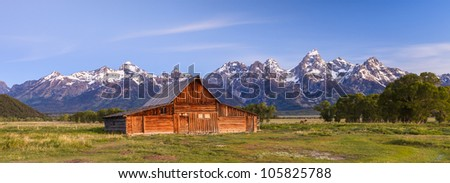 Old barn in front of the Grand Tetons in Wyoming - stock photo