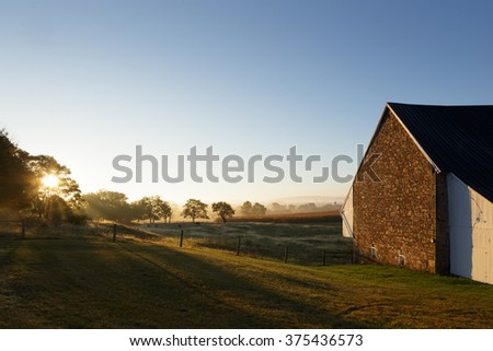 Old barn in the sunrise