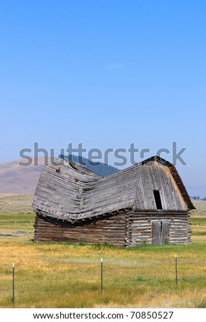 Old barn in western Montana with roof caving in.