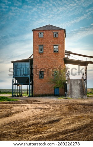 Old barn on background the blue sky - stock photo