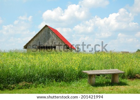 old barn on field