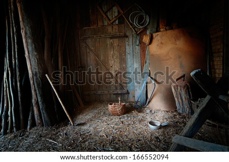 Old barn with a lot of tools and equipment - stock photo