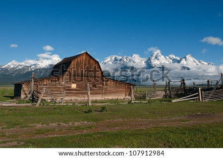 Old Barn Yard in Front of Grand Tetons - stock photo