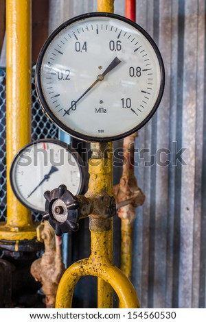 old barometer on the yellow tube - stock photo
