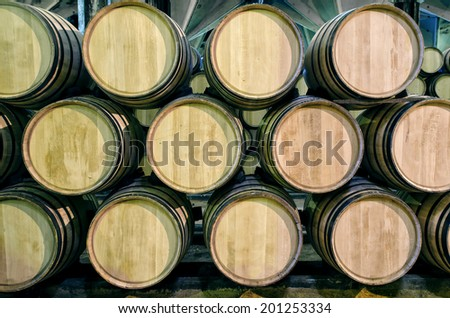 Old barrels for Whisky or wine in cellar  - stock photo