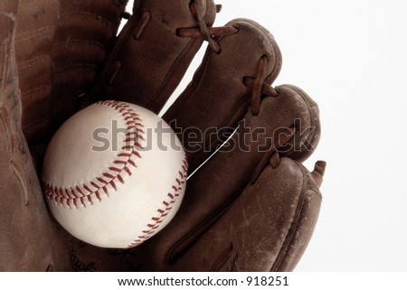 Old Baseball and Glove on White Background