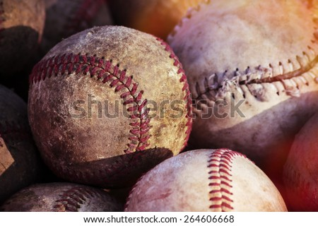 Old baseball balls close up background.  Post processed with vintage filter.  - stock photo