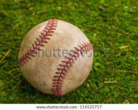 Old Baseball on grass