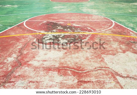 Old basketball  court red and green   - stock photo
