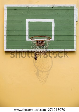 Old basketball hoop on empty outdoor wall. - stock photo