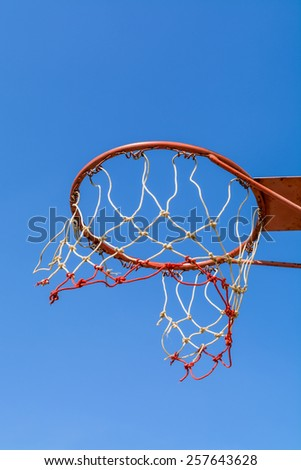 Old basketball hoop with blue sky - stock photo