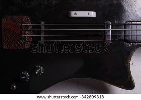old bass guitar on white background - stock photo