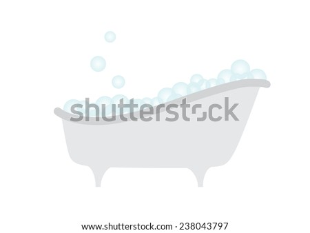 Old bathtub with blue bubbles of soap suds isolated on white background.