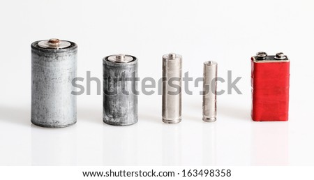 Old batteries isolated on white background - stock photo