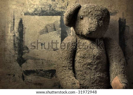 Old bear on the wood background - stock photo