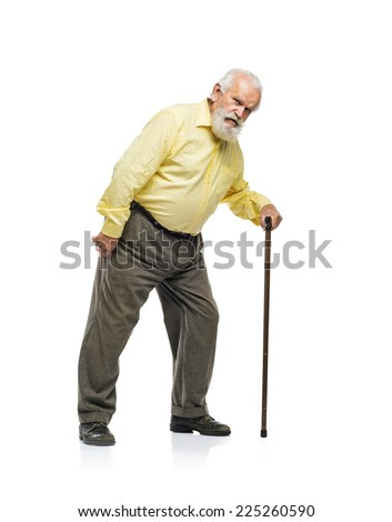 Old bearded man walking with cane isolated on white background - stock photo