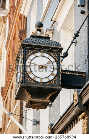 Old beautiful clock city on the avenues of London, United Kingdom - stock photo