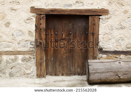 Old beautiful door in house in Bansko, Bulgaria