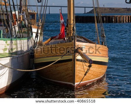 Old beautiful vintage wooden sail boat tall ship