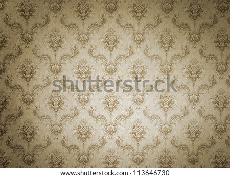 Old beige wallpaper for texture or background - stock photo