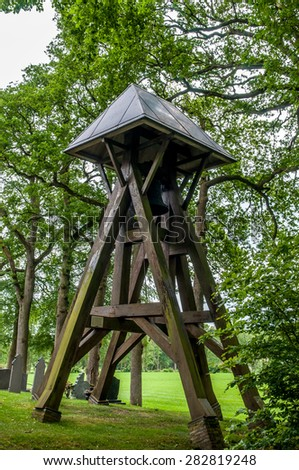 Old bell tower in a cemetery in Netherlands - stock photo