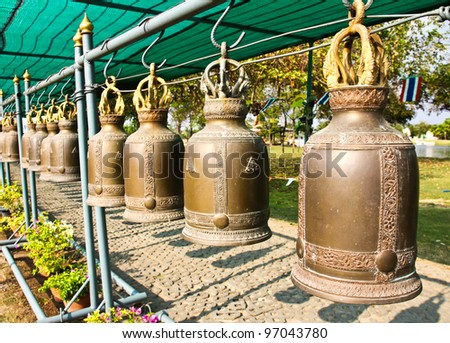 Old bells in a buddhist temple of Thailand. - stock photo