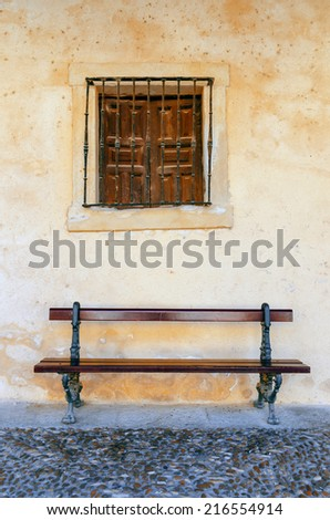 Old bench and window on the streets of Burgo de Osma, Soria, Spain - stock photo