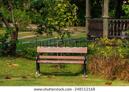 Old Bench in public park to relax. - stock photo
