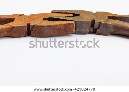 old bench tools, pliers, different and rusty, linked the two, on a white background - stock photo