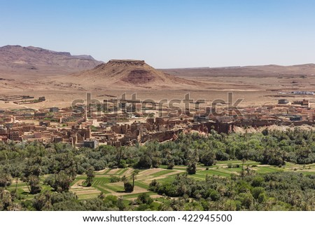 Old berber village in desert oasis, Morocco - stock photo