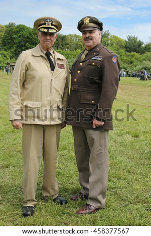 OLD BETHPAGE , NEW YORK - MAY 22, 2016: World War II Encampment participants in World War II American Army uniform in Old Bethpage, NY
