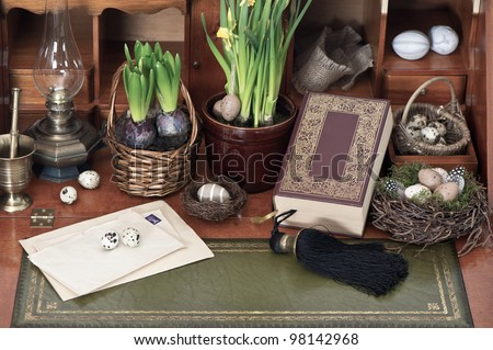 old bible book with easter eggs, plants and vintage things - stock photo
