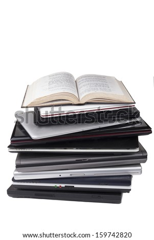 Old Bible in hebrew on top of laptop pile isolated on white background - stock photo