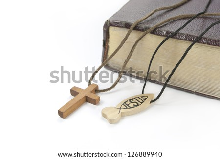 old bible, pendants with cross and ichtus sign - stock photo