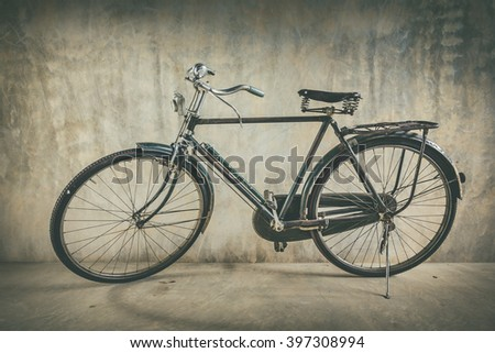 Old bicycle and background wall old vintage style.