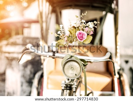 Old bicycle and flowers, vintage and retro filter style - stock photo