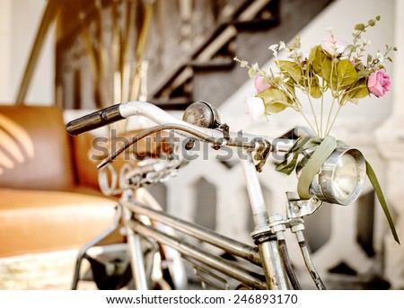 Old bicycle and flowers, vintage and retro style - stock photo