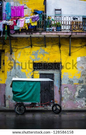 Old bicycle and shabby buildings in Old Havana - stock photo